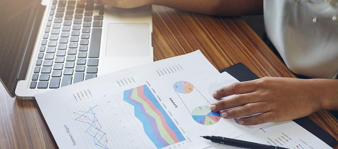 Reviewing website metrics paperwork